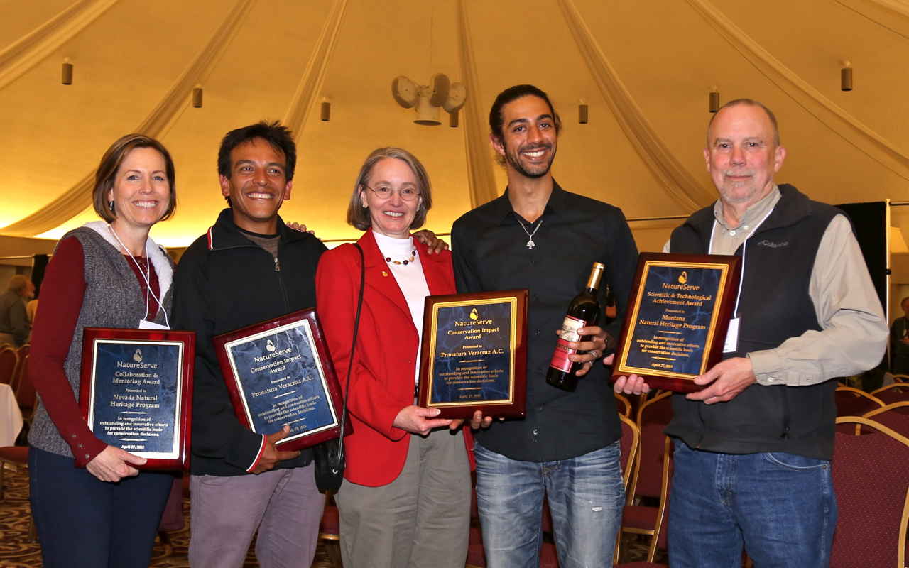 Mary Klein (center) with the winners of this year's Member Awards, from left: Kristin Szabo of the Nevada Natural Heritage Program, Anibal Ramirez and Fadi Farhat of Pronatura Veracruz, and Allan Cox of the Montana Natural Heritage Program.
