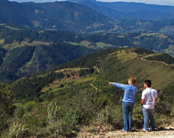 NatureServe scientists look out over a patchwork landscape near Santuario de Flora y Fauna Iguaque in Santander, Colombia. Photo by Bruce Young | NatureServe