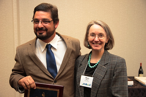 SalvaNATURA executive director Alvaro Moises receives the 2012 Conservation Impact Award from NatureServe president and CEO Mary Klein.